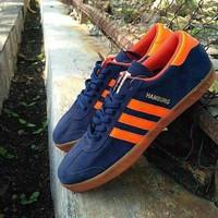 Sepatu sneaker Adidas Hamburg navy oren casual football murah