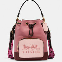 COACH Jes Drawstring Bucket Bag In Colorblock Horse And Carriage PINK