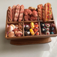 Miniatur clay roti cake display