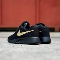 Nike black gold