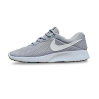 NIKE Tanjun Sepatu Sneaker Pria - Grey List White