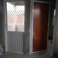 pintu alumunium kasa nyamuk + Spandreal