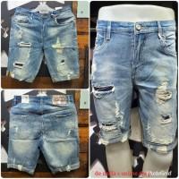 Celana pendek jeans import pria stretch fashion model sobek tambal .