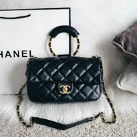 chane** classic round handle flap bag