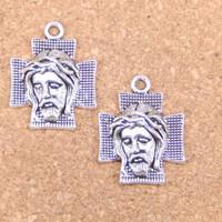 salib rosario wajah Yesus