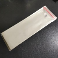 KEMASAN PLASTIK SEAL OPP 9 X 25 X 03 - PLASTIK BENING - 100 LEMBAR