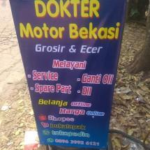 dokter motor Logo