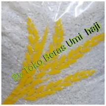 Beras umi haji Logo
