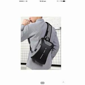 Harga tas selempang anti maling slim dilengkapi dengan usb charging port   | HARGALOKA.COM